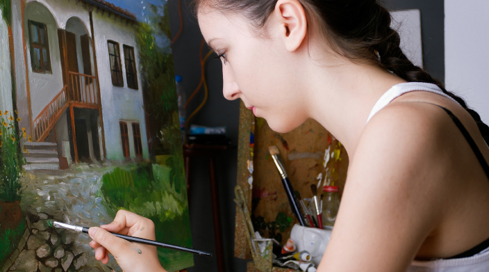 Photo of an art student painting